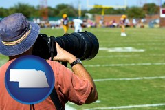 nebraska map icon and a sporting event photographer