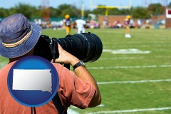 south-dakota map icon and a sporting event photographer