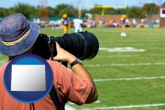 wyoming map icon and a sporting event photographer