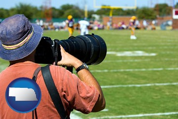 a sporting event photographer - with Nebraska icon